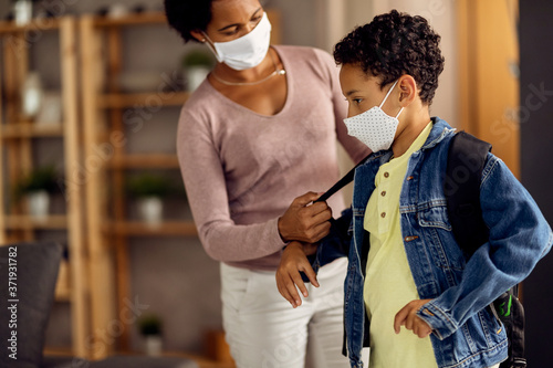 African American boy with protective face mask preparing for school day Canvas Print