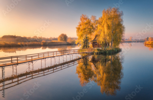 Old fisherman house and wooden pier at sunrise in autumn Canvas-taulu