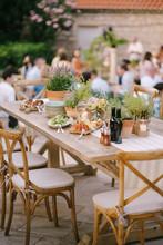 A Festive Table With Fresh Flo...