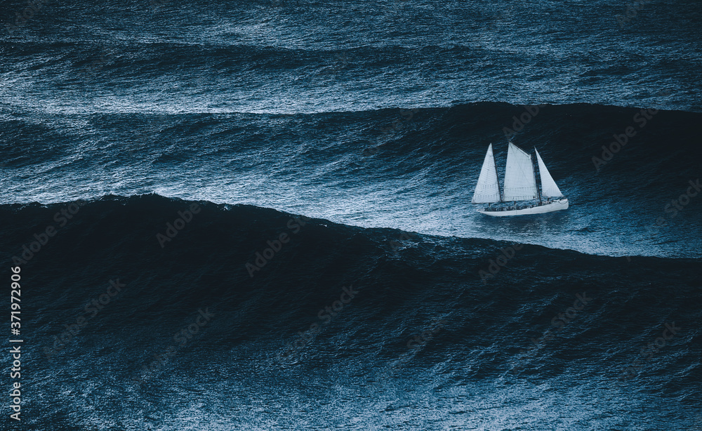 Fototapeta sailboat on the sea with storm and big waves