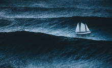 Sailboat On The Sea With Storm And Big Waves