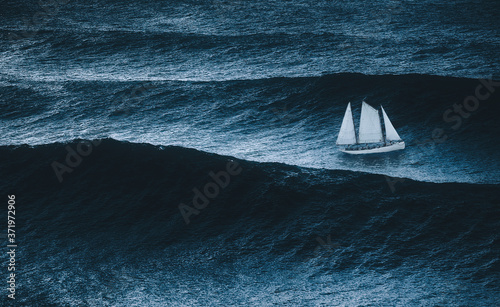Photo sailboat on the sea with storm and big waves