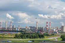 Helicopters Fly Over An Industrial Area On The Outskirts Of Moscow