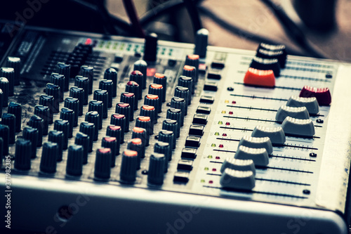 audio mixing console with knobs and faders Fototapete