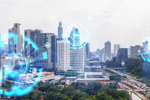 Canvastavla Abstract technology icons hologram over panorama city view of Kuala Lumpur, Malaysia, Asia