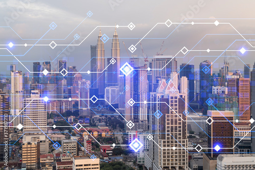 Leinwand Poster Glowing hologram of technological process, aerial panoramic cityscape of Kuala Lumpur at sunset