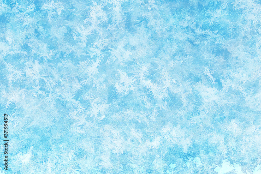 Fototapeta Winter ice frost, frozen background. frosted window glass texture. Cold cool icicles background. Winter wonderland scene. Natural, decoration.