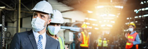 Close up face of business engineer manager wear mask in suit and white safety helmet in factory on industry, worry and anxious worker protect and safe during Coronavirus or Covid-19 concept
