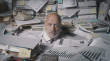 Stressed accountant overwhelmed by work