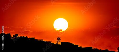 Obraz na plátně Pôr do sol na cidade