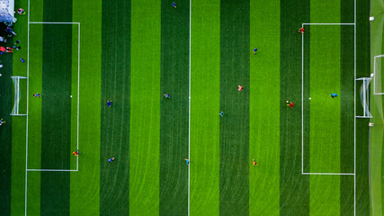 Aerial photograph of players on a football field in Dalian, Liaoning Province, China