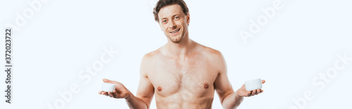 Foto Panoramic orientation of shirtless man holding jars of cosmetic creams isolated
