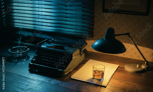 Vintage writer desktop with typewriter and a glass of whiskey Fototapet