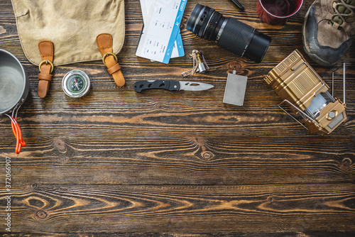 Fotografia, Obraz Hiking equipment for tourism on wooden table