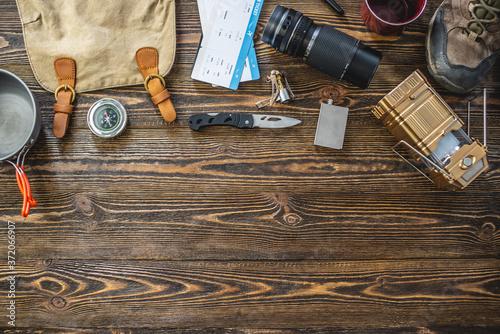 Fotografija Hiking equipment for tourism on wooden table