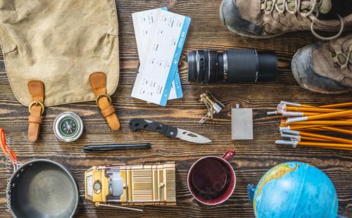 Fototapeta Hiking equipment for tourism on wooden table