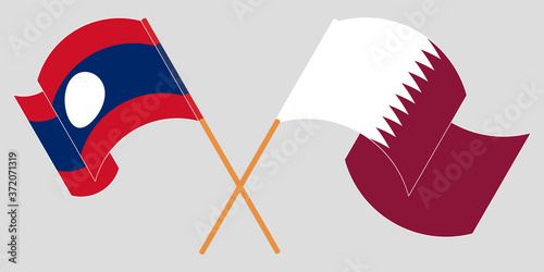 Fotografering Crossed and waving flags of Laos and Qatar