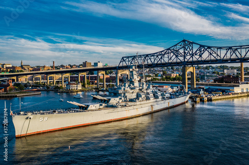 Photo bridge over the river and battleship