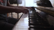 Male Musician Plays An Old Vintage Yamaha Piano, Side View With Shallow Depth Of Field 4K