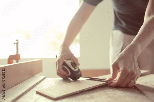 Fototapeta cutting wood for building,  carpenter, worker  obraz na płótnie