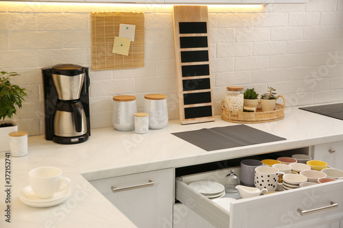 Valokuva Stylish kitchen interior with modern coffeemaker on countertop