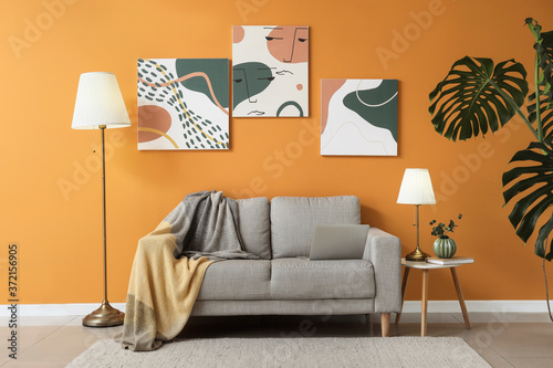 Fotografiet Stylish interior of living room with sofa and lamps