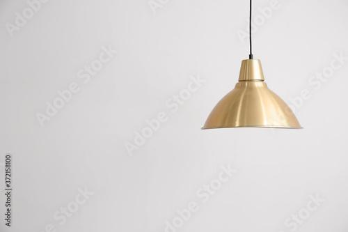 Stylish lamp hanging near light wall Canvas Print