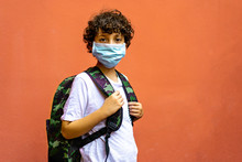 Cute Elementary Schoolboy With Backpack Going Back To School During 2020 Coronavirus (Covid-19) Pandemic Disease, Kid Wearing A Protective Face Mask