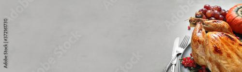 Fotografie, Obraz Tasty turkey served on grey table, space for text. Banner design