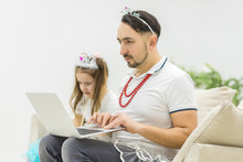 Photo Where Father Teaches His Daughter Holding Laptop.
