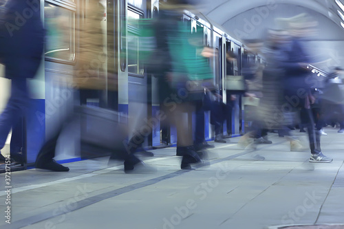 Fotomural crowd of people metro in motion blurred, abstract background urban traffic peopl