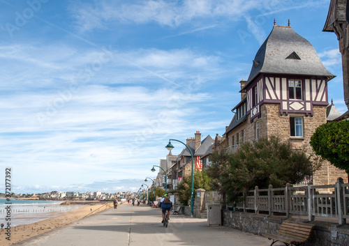 Fototapeta People walking along promenade at seafront in Saint Malo, Brittany, France