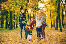 Family Playing At City Park Mo...