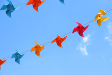 Colored Paper Lanterns Set Against Blue Sky