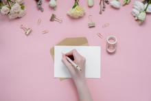 Female Hands Writing Wish List...