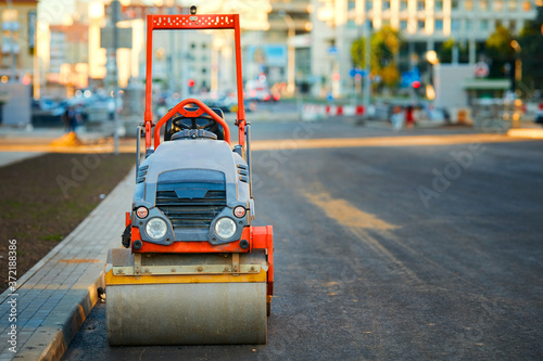Fotografie, Obraz Road repairing in city with small vibration roller compactor