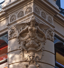 Sculpture Of A Figurehead On The Corner Of A Magnificent Building