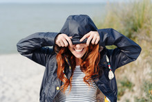 Playful Young Woman Hiding Her Eyes