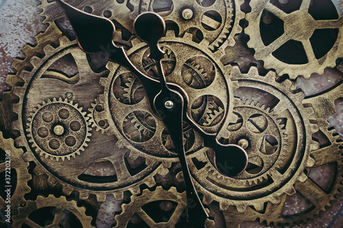 Mécanisme en métal d'une horloge - Roues d'horlogerie Fotobehang