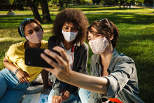 Image Of Nice Student Girls In Face Masks Taking Selfie On Mobile Phone