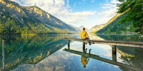 Leinwand Poster Sitzen am See, Stille genießen