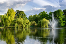 Beautiful City Gardens And Park With A Pond And Geyser Fountain