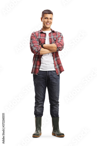 Full length portrait of a male gardener in boots posing with crossed arms Fototapet