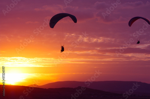 Paragliding on the sunset, taken in September, Crimea, Ukraine Billede på lærred