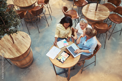 Diverse businesswomen working together in an office cafeteria Fotobehang