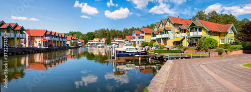 Harbor village Rheinsberg-Brandenburg with traditional houses on a sunny day in Fototapete
