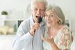 canvas print picture Close up portrait of senior couple singing karaoke