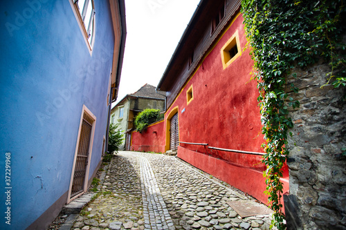Beautiful colorful street in Sighisoara in typical traditional style Fototapet