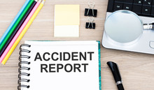 Accident Report Text On A Notebook Lying On The Table