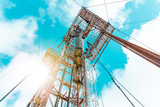 Drilling rig with a tower tower. Oil drilling rig operation on the oil platform in oil and gas industry.